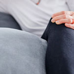Woman with knee pain and inflammation