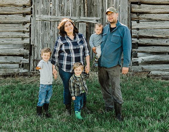 Rivett-Carnac Family by their barn at St Francis Herb Farm