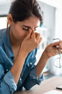 Woman with Headache in need of Natural Headache Relief